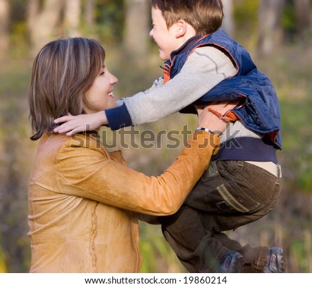 Mother and son playing in autumn park #19860214
