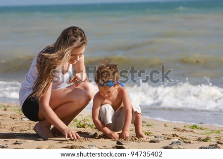 mother and son playing on beach