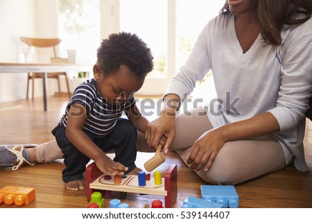 Mother And Son Playing With Toys On Floor At Home #539144407