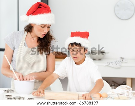 Mother and son preparing Christmas biscuits together in the kitchen