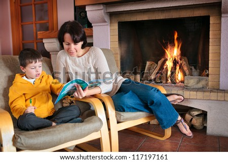 Mother and son reading a book - stock photo