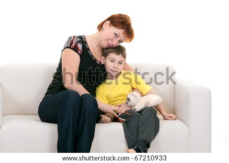 Mother and son sitting on the couch