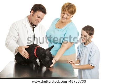 Mother and son take their pet Scotty dog to the veterinarian.  Isolated on white.