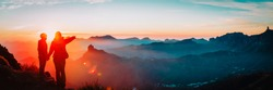 mother and son travel in mountains at sunset, panorama