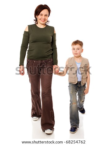 Mother and son walking together isolated on white