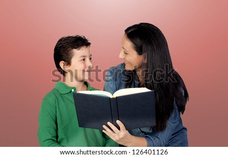 Mother and son with a book isolated on red background