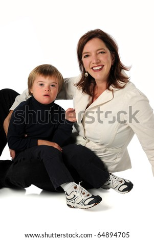 Mother and son with Down syndrome sitting isolated over white background