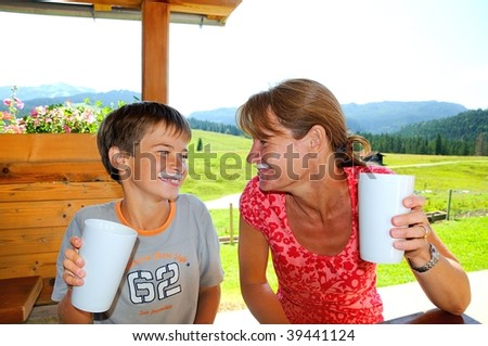 Mother and son with funny milk mustache