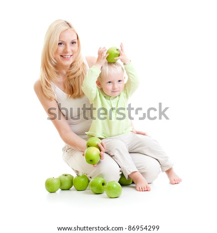 mother and son with green apples isolated