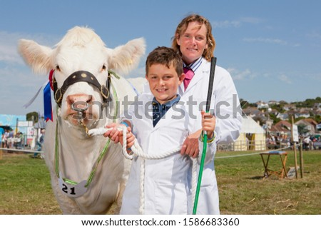 Mother And Son With Prize Winning Cow At Agricultural Show