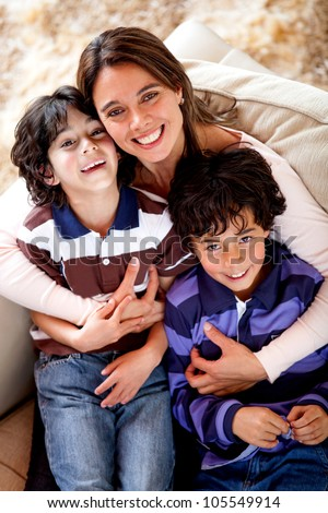 Mother and sons looking happy and smiling