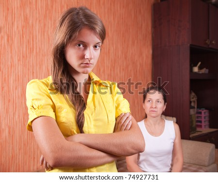 Mother and teen daughter having quarrel at home