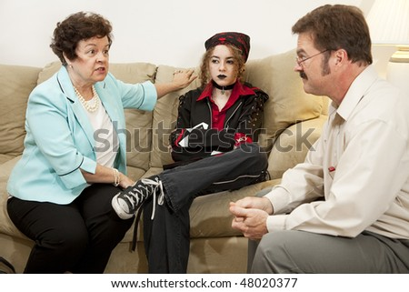 Mother and teen daughter in family counseling. - stock photo