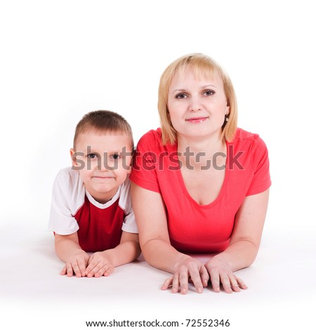 Mother and the son lie on a floor. Isolated on a white background