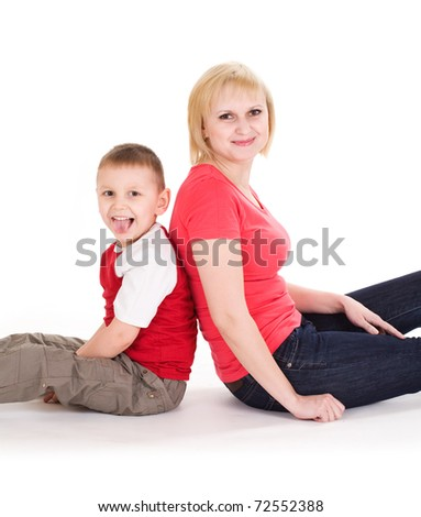 Mother and the son sit on a floor. Isolated on a white background - stock photo