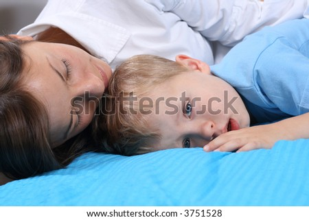 mother and three years old boy in bed