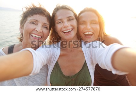 mother and two adult daughters are doing Selfe on the beach #274577870