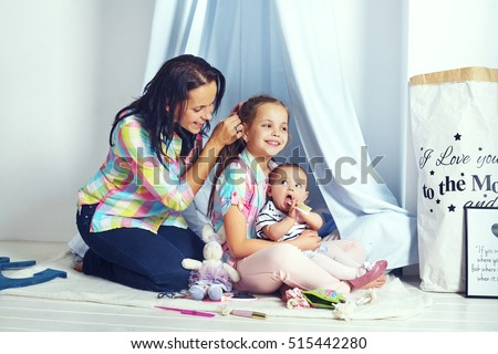 mother and two daughters. The concept of family and lifestyle Stockfoto ©