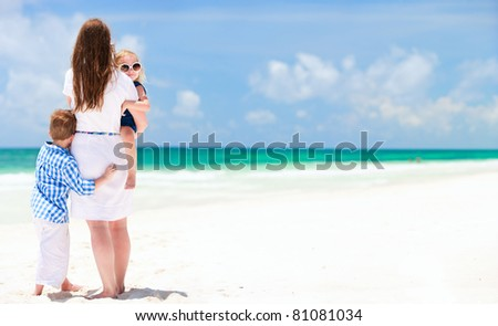 Mother and two kids at stunning tropical beach