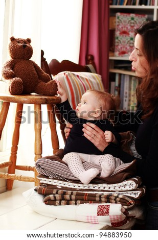 mother and young daughter in home interior