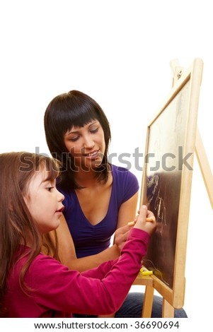Mother and young daughter using a blackboard