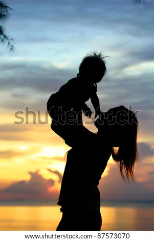 Mother & Baby Silhouette  in sunset time - stock photo