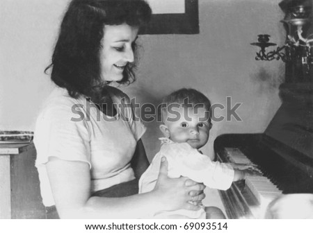 mother,babygirl and piano - stock photo