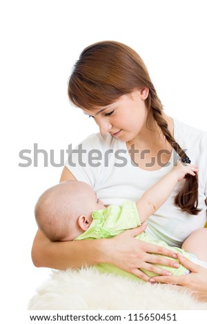 mother breast feeding and hugging her baby girl isolated on white