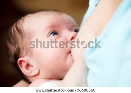 Mother breast feeding newborn baby