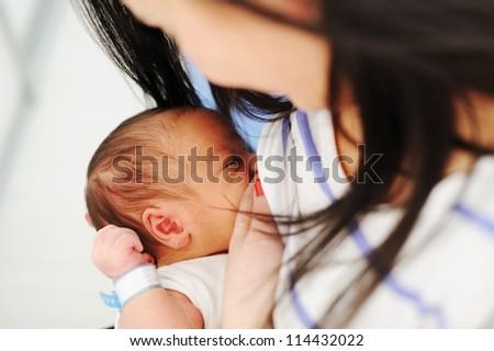 Mother Breastfeeding her newborn