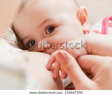 Mother care. Breast feeding baby.