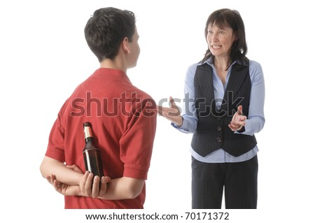 Mother caught her teenage son with a bottle of beer and scolds him isolated against a white background.