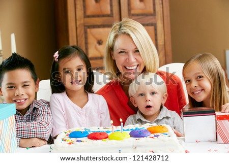 Mother Celebrating Child's Birthday With Friends