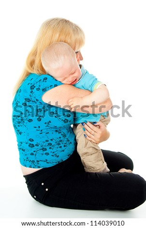 mother comforting a crying baby in her arms
