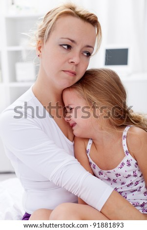 Mother comforting her crying child