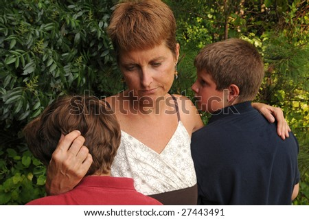 mother comforts crying children