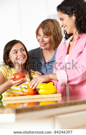 Mother,daughter and grandmother cooking