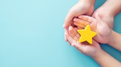Mother day Concept, Best Excellent mother mom, kid giving a Star Rating to mother.Mother and kid child hand holding star for reward.Family, encourage, School, Student.Child development.Proud, Gifted.