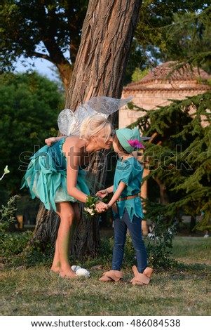 Mother dressed as a fairy and her son as Peter Pan
