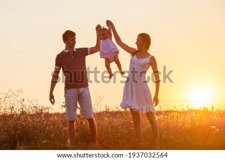 Mother, father and child daughter having fun outdoors. Stock photo ©