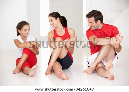 Mother father and daughter doing yoga