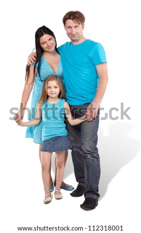 Mother, father and little daughter stand embraced and holding hands