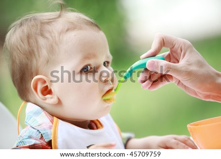 Mother feed her lovely baby