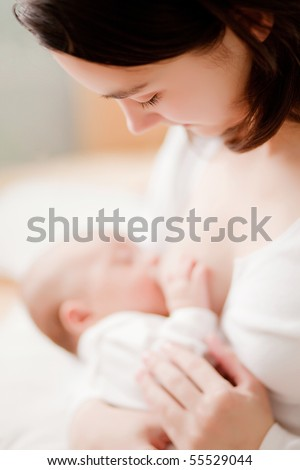 mother feeding baby soft focus