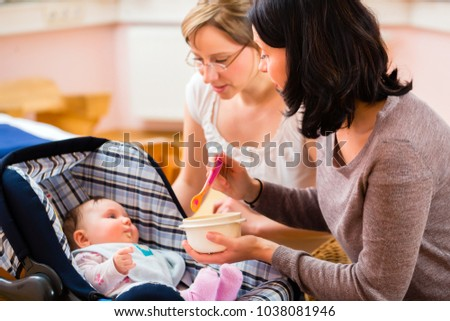 Mother feeding her baby at midwife practice Stock photo ©