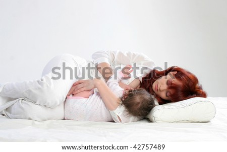 Mother feeding her baby. Side lying
