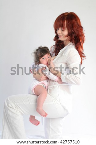 Mother feeding her baby. Sitting on the lap