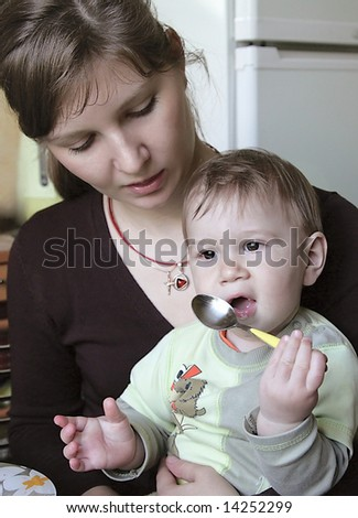 Mother feeds the child.