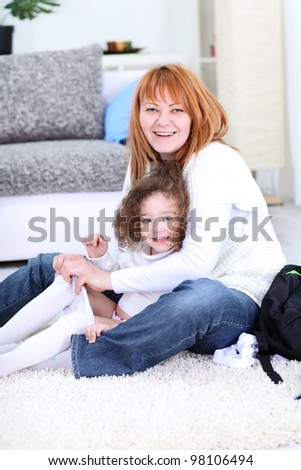 mother  fixing jeans her daughter