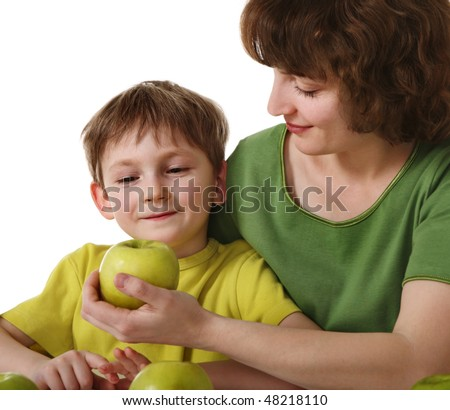Mother gives son an apple